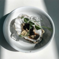 Oyster with balsamic pearls